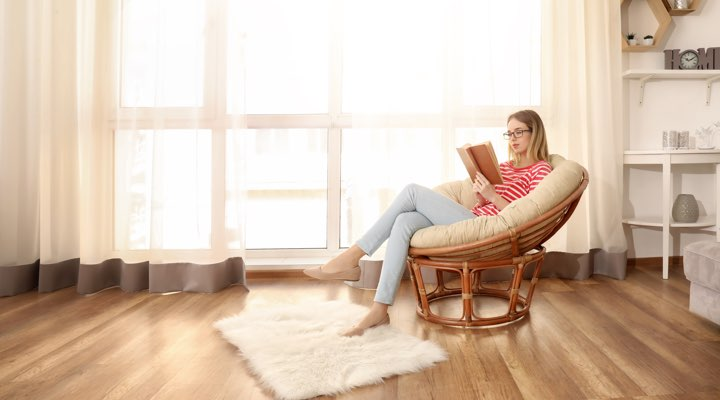 Photo of woman relaxing in spacious room